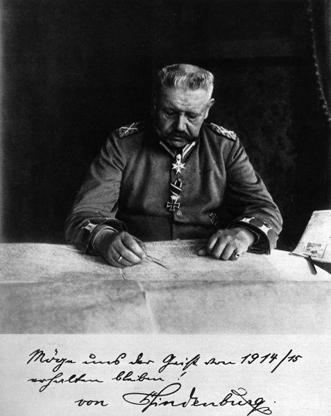 Photograph of Marshal Paul von Hinderburg (1847-1934), sitting at a strategic map. A veteran of the Franco-Prussian War, he was recalled from retirement on the outbreak of World War I, winning decisive victories on the Eastern front at Tannenburg