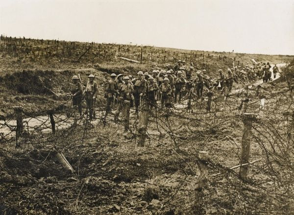 British troops contemplate the strong wire defences of the Hindenburg Line