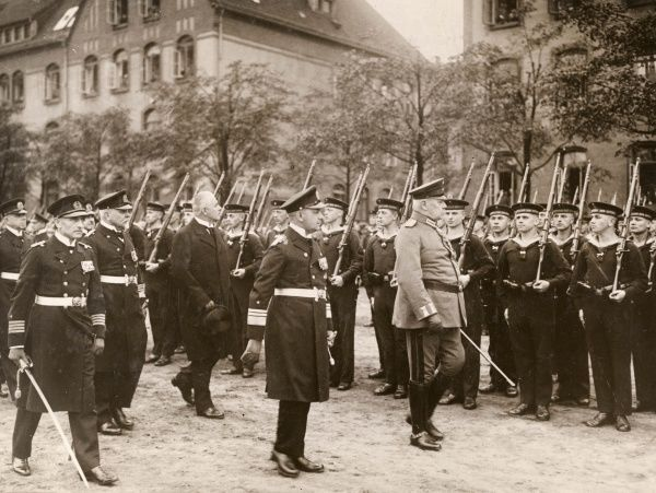 President Paul von Hindenburg at a naval inspection in Kiel. Just behind him is Admiral Erich Raeder, Chief of the Kiel Station, and further back is Admiral Hans Zenker, Chief of the Fleet