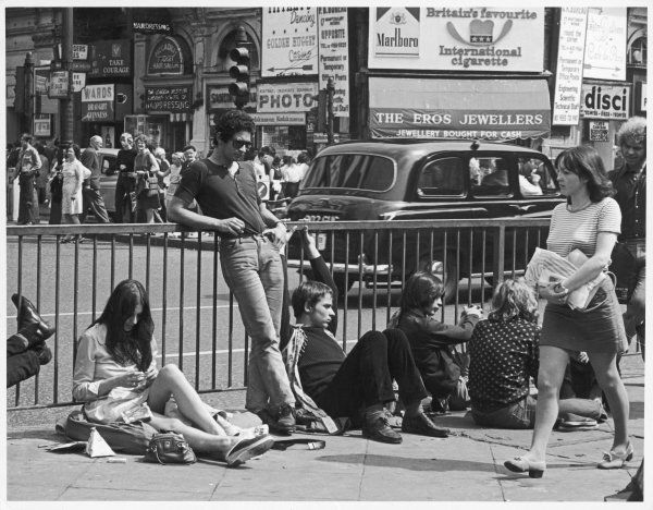 Young people hang around Piccadilly Circus in London