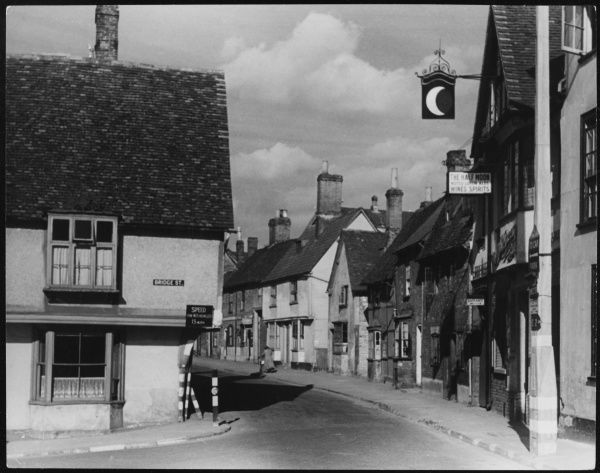 The corner of Bridge Street, Hitchin, Hertfordshire, where the speed limit for 'W.D.' (War Department) vehicles is 15 m.p.h. The Half Moon pub, sells 'Noted Luton Ales', too