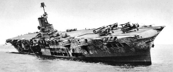 Photograph showing the Royal Navy aircraft-carrier HMS 'Ark Royal' listing heavily to starboard, after being torpedoed in the Mediterranean Sea in November 1941