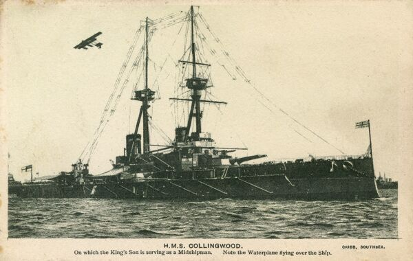 The HMS Collingwood with a seaplane flying overhead. A St Vincent Class Dreadnought Battleship, launched in 1908, commissioned in 1910 and scrapped in 1922. Prince Albert, later King George VI served onboard HMS Collingwood as a midshipman. Date