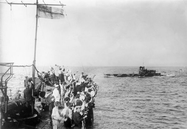 The crew of the HMS Grampus (a Beagle-class destroyer) cheering the surfaced HMS E11 submarine after a successful attack on Turkish defences at Gallipoli during the First World War. Date: 1915