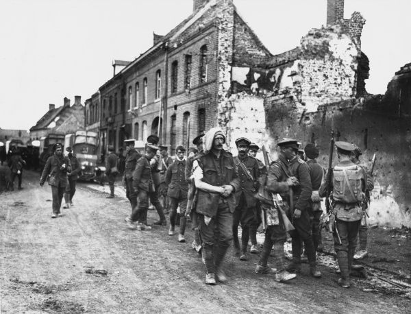 Wounded soldiers returning to a Dressing Station through Vermelles during the attack on the Hohenzollern Redoubt on the Western Front in France during World War I on 13th October 1915