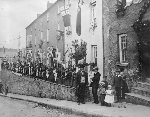 Scene in Gloucester Terrace, The Holloway, Haverfordwest, Pembrokeshire, South Wales, decorated with flags and bunting to celebrate the coronation of King Edward VII