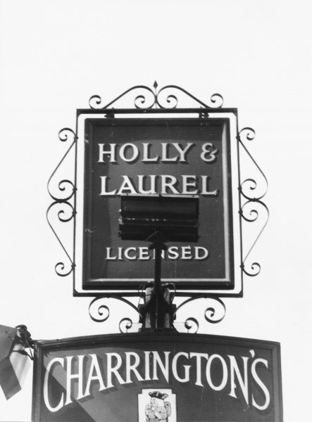 The 'Holly and Laurel' a Christmassy inn sign at Holmwood, Surrey, England