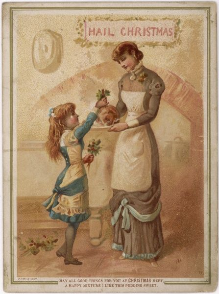 While mama holds the pudding, her daughter crowns it with a sprig of holly