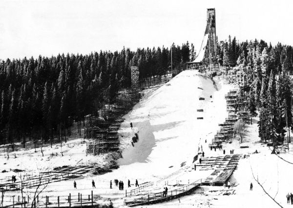 The ski jumping hill at Holmenkollbakken, Oslo, Norway, This 'new' ski jump has a speed-scaffold which gives better jumping length. Date: 1930s