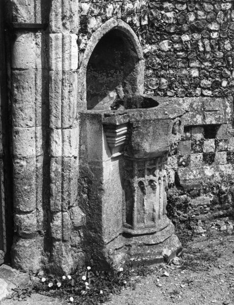 The Holy Water Stoup at Blythburgh Church, Suffolk, England. This receptacle is an unusually large vessel and may have been used as an outdoor font for illegitimate baptisms Date: Medieval