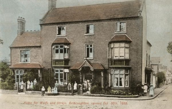 Some of the residents stand in front of the Home for Waifs and Strays at Belbroughton, Worcestershire, opened in 1889