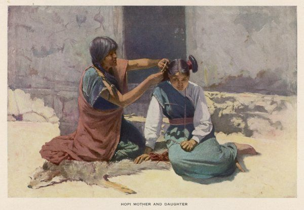 A Hopi mother of Arizona arranges her daughter's hair in the traditional style