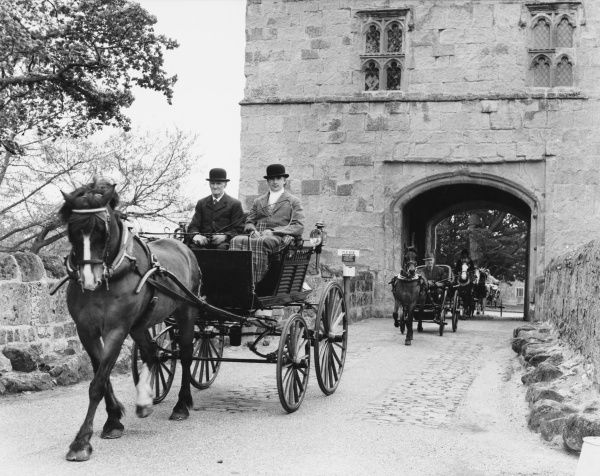 Horse driving enthusiasts attending a rally in and around Michelham Priory, Sussex, England, including four-wheeled carriages, pony chaises and dog carts. Date: 1960s
