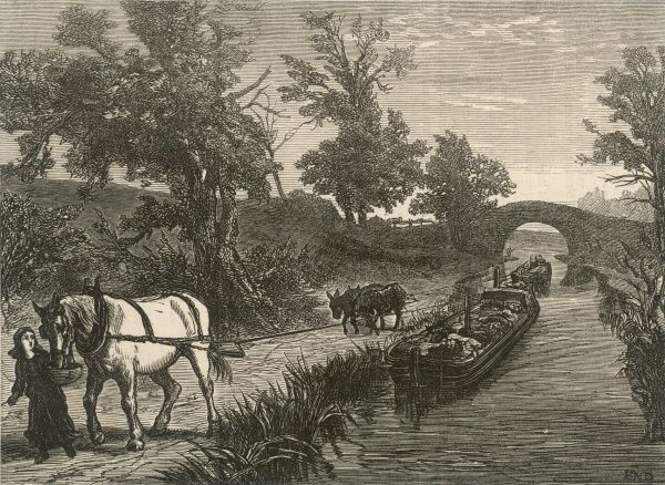 On the road: two canal barges are pulled along by horses on the river bank; the lead horse is tempted onwards with a bowl of food