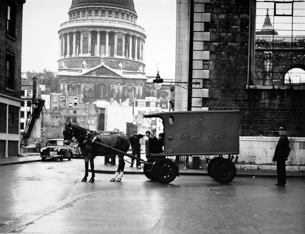 The last horse drawn mail van, 'Peter', leaving K.E.B on Saturday 24th September 1949. In the background are the still bomb-damaged streets of the St. Pauls area of London. Date: 24th September 1949