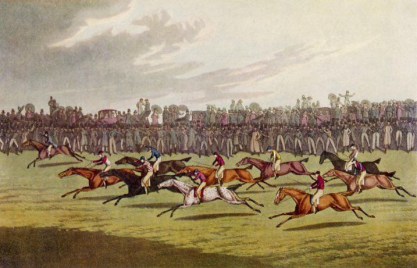 A horse race in progress, watched by a large crowd