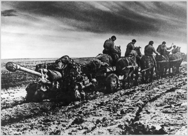 Horse-drawn Soviet artillery pulled through the mud of a Russian thaw