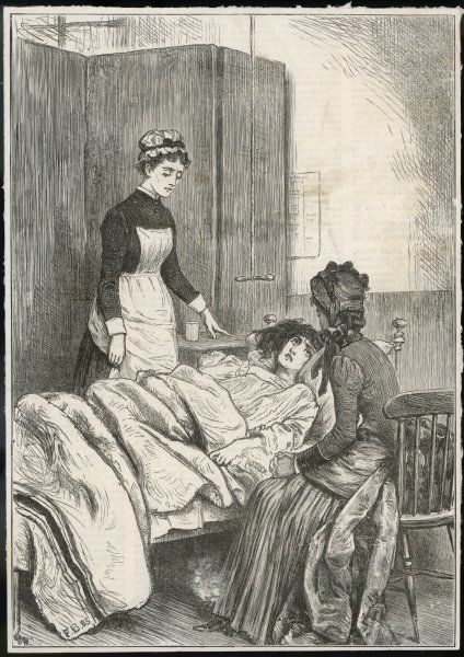 A hospital patient receives a visitor, while a nurse stands by