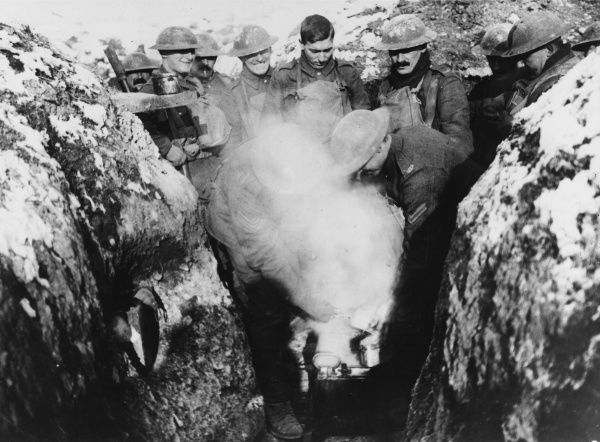 British troops receive hot stew in the trenches near Cambrai in France on the British front during World War I in March 1917