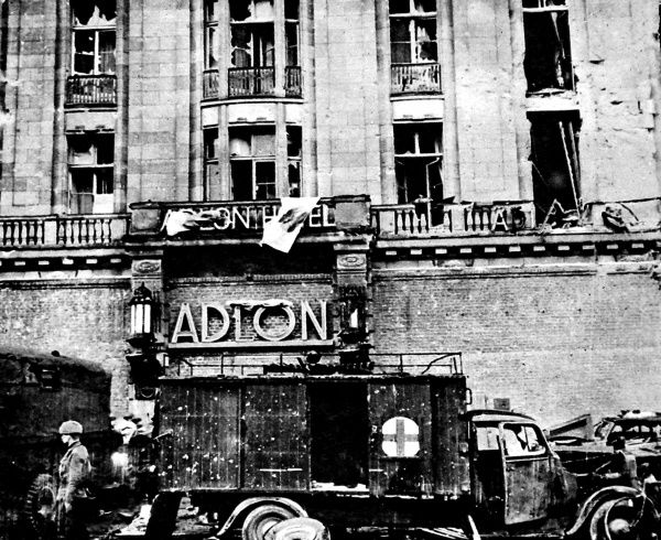 Photograph showing the heavily damaged Hotel Adlon, in Unter den Linden, Berlin, with Soviet vehicles in front of the entrance, May 1945