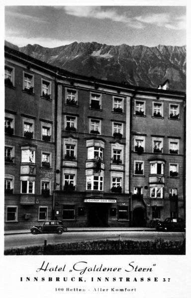 "The Hotel ""Goldener Stern"" or Golden Star, with the Alps in the background, on Innstrasse, Innsbruck, Austria. Date: circa 1955"
