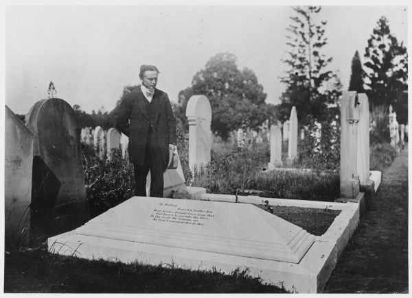 Harry Houdini at the grave of William Davenport, American stage magician who with his brother Ira deceived many with their supposed spirit seances