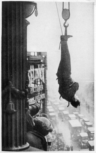 Suspended from the cornice of a New York skyscraper, he must somehow free himself of his chains and make his way to safety... will he do it ? Is this one trick too many ?