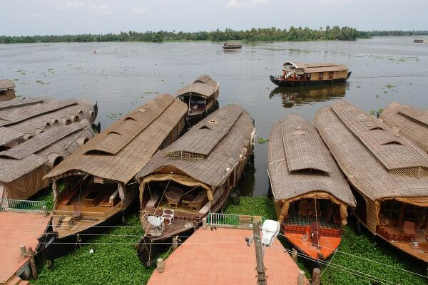 House boats (rice boats) moored at a pier in Alleppey, Kerala State, India. The small town of Alleppey, or Alappuzha, has been described as 'the Venice of the East' because of its network of canals