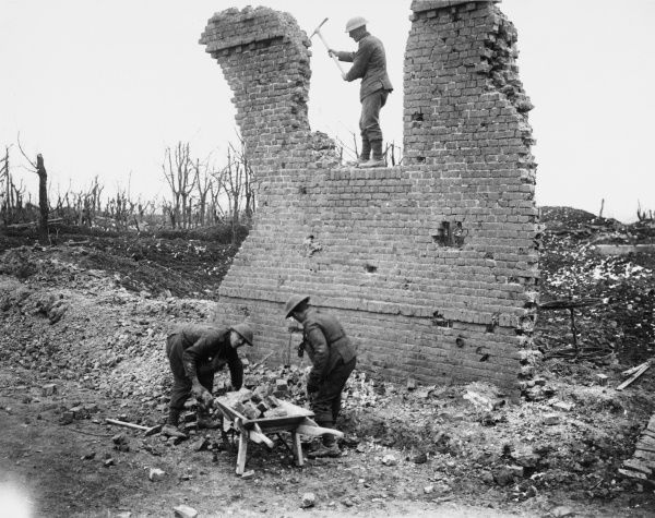 Soldiers demolishing a house recycling bricks in the ruins of Gommecourt on the British Front in France during World War I in March 1917