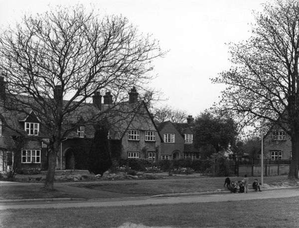 A row of houses on a wide road in Letchworth Garden City, Hertfordshire Date: 1950s