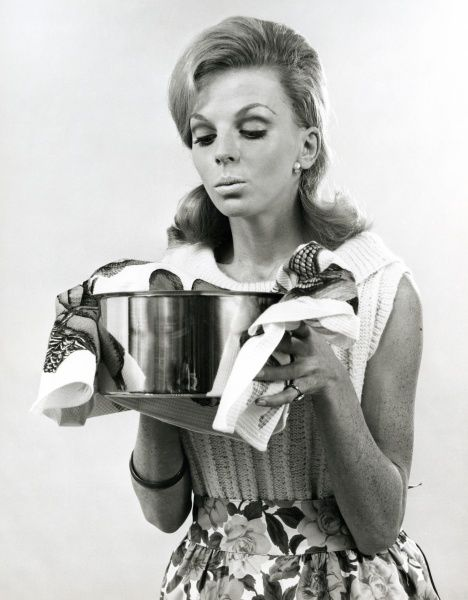 A woman holds a hot pan