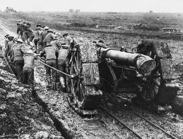 6 inch 26 cwt Howitzer gun being manhandled through the mud near Pozieres during World War I in September 1918