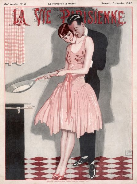An elegant young couple in the kitchen: she cooks crepes, he whispers sweet-nothings into her ear