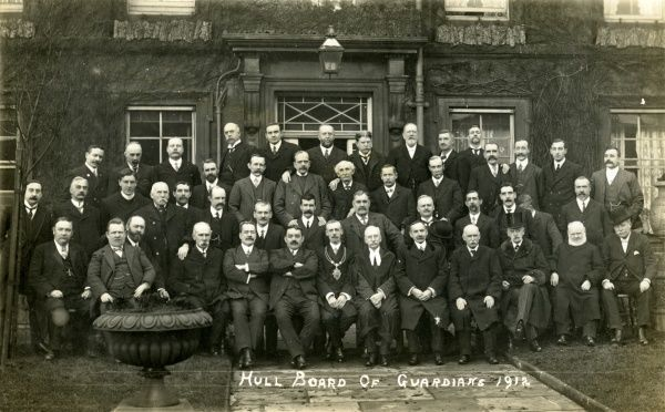 A Board of Guardians was elected annually by the ratepayers of Hull, Yorkshire, to administer poor relief in the city. This group portrait of the 1912 Board - all men - was taken in front of the main workhouse building. The Chairman of the Board