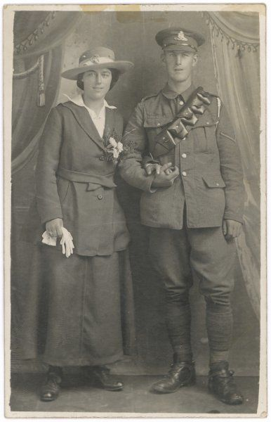 A middle-class couple, possibly on their wedding day: he wears his uniform