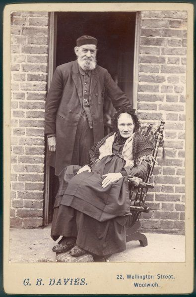 An old couple of Woolwich outside their home