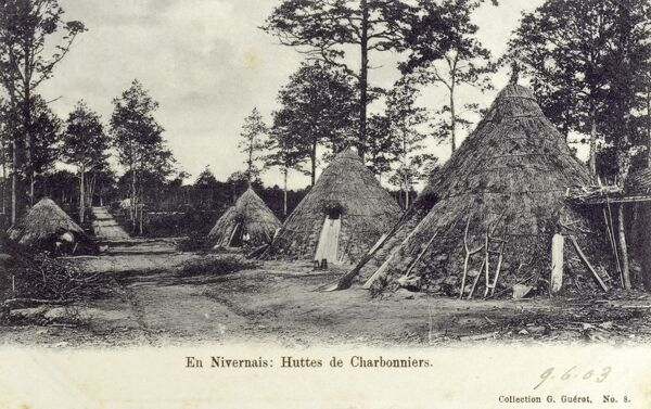 The conical huts of charcoal burners in the woods close to Nevers, France Date: 1903