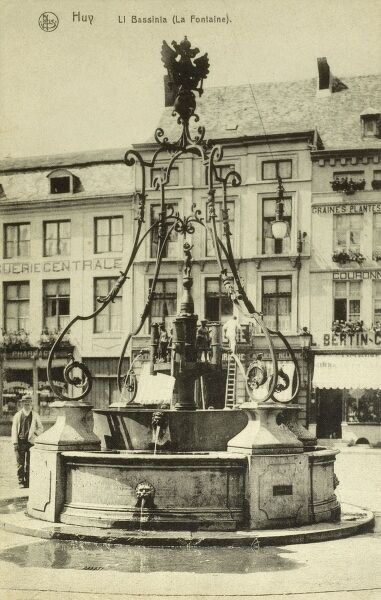 Huy, Belgium - the old fountain 'Li Bassinia' (combination of work from the 15th and 18th centuries). Date: circa 1910s