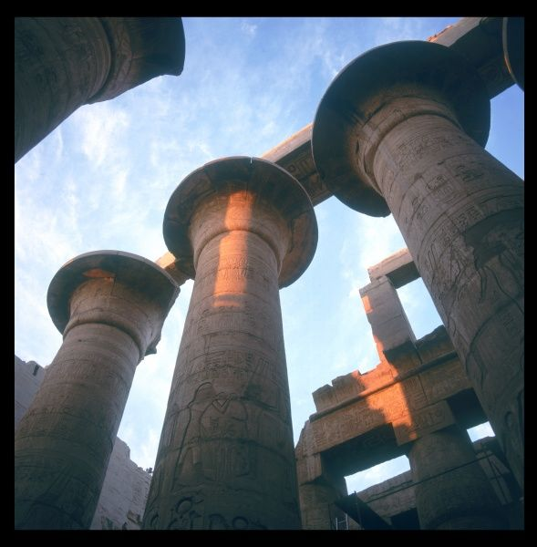 The 'Papyrus' pillars of the Great HYPOSTYLE HALL, at sunset. Begun in the reign of Rameses I and completed in the reign of Rameses II, Karnak Thebes (modern Luxor), Egypt
