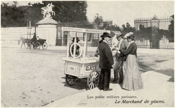 'Le marchand de glaces'- a Parisian ice-cream seller with his barrow, at the entrance to a park