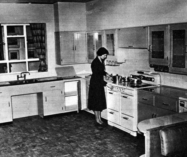 A kitchen at the Ideal Home Exhibition at Olympia, 1951, featured in a spread in Sport & Country magazine: the country housewife at Olympia; this year's Ideal Home Exhibition has much to interest her. The egg-shell blue fitments are by Peerless