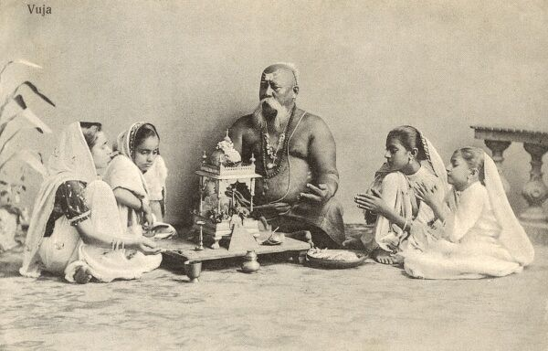 Vuja - an Indian Guru pictured with his young devotees Date: circa 1910s