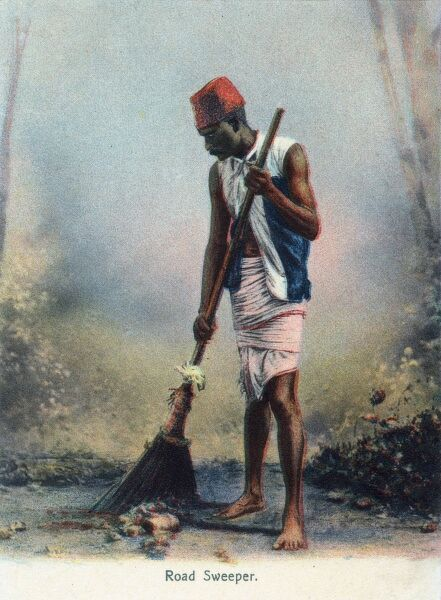 India - Road Sweeper brushing away with his broom