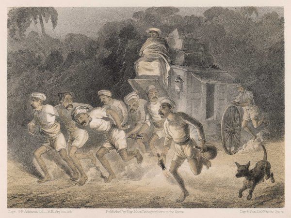 A team of hauliers pull a wagon through the Indian night (when it's cooler)