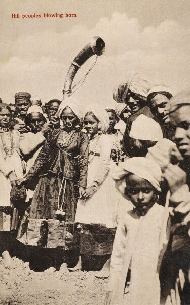 Indian Hill People (close to Ambala, Punjab, north central India) blowing horns. Possibly a marital party. Date: circa 1910s