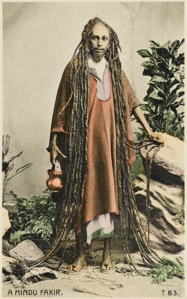 A superb photograph (on a postcard) of a Hindu Indian Fakir with immensely long hair