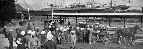Photograph showing a group of Hindu Indians arriving in Canada, with the docks in the background, Vancouver, 1907. This group disembarked from the steamer 'Monteagle&#39