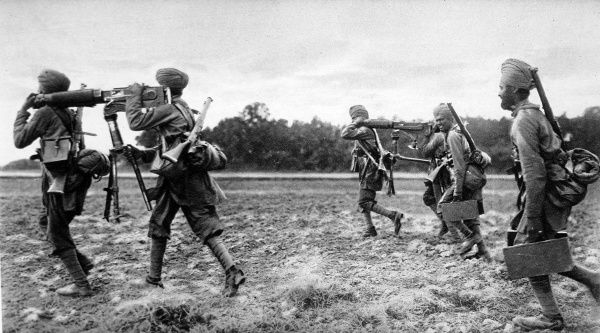 Indian troops taking their maxim machine guns to the firing line in world war one