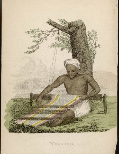 An Indian weaver at work in the shade of a tree