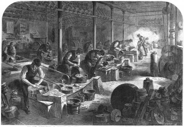 Sheffield : razor-grinders at work in the 'hull' Date: 1866